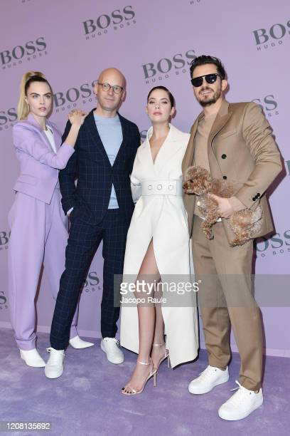 Cara Delevingne Mark Langer Ashley Benson and Orlando Bloom with his dog Mighty attend the Boss fashion show on February 23 2020 in Milan Italy