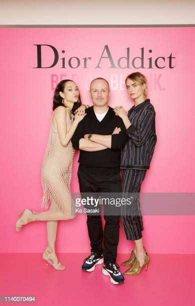 Cara Delevingne Peter Philips and Kiko Mizuhara pose for photographs during the Dior Addict Stellar Shine launch on April 2 2019 in Tokyo Japan