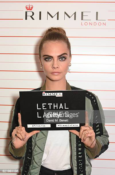 Cara Delevingne poses as she and Rimmel celebrate their new partnership and launch the new Scandaleyes Reloaded Mascara at The Ace Hotel on November...