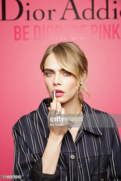 Cara Delevingne poses for photographs during the Dior Addict Stellar Shine launch on April 2 2019 in Tokyo Japan