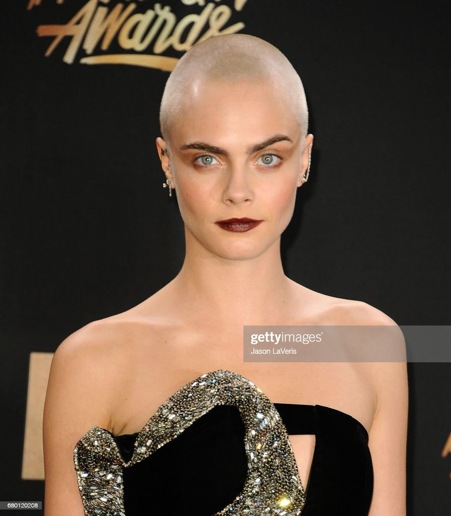 Cara Delevingne poses in the press room at the 2017 MTV Movie and TV Awards at The Shrine Auditorium on May 7, 2017 in Los Angeles, California.