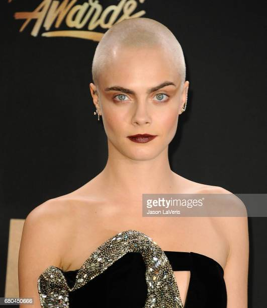 Cara Delevingne poses in the press room at the 2017 MTV Movie and TV Awards at The Shrine Auditorium on May 7 2017 in Los Angeles California