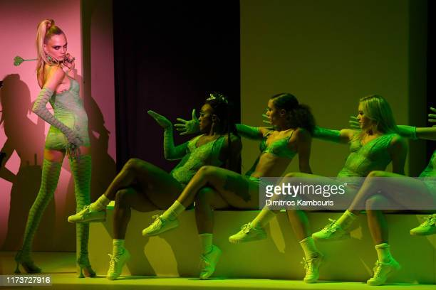 Cara Delevingne poses onstage for Savage X Fenty Show Presented By Amazon Prime Video - Show Sneak Peak at Barclays Center on September 10, 2019 in...