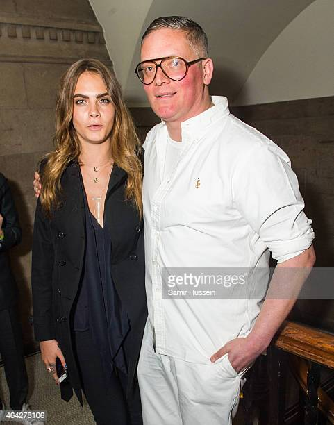 Cara Delevingne poses with designer Giles Deacon backstage at the GILES show during London Fashion Week Fall/Winter 2015/16 at Central Saint Martins...