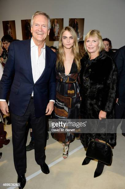 Cara Delevingne poses with parents Charles Delevingne and Pandora Delevingne attend the front row at Burberry Womenswear Autumn/Winter 2014 at...