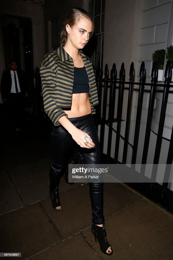 Cara Delevingne seen leaving The Firehouse and arriving at her London home on April 30, 2014 in London, England.