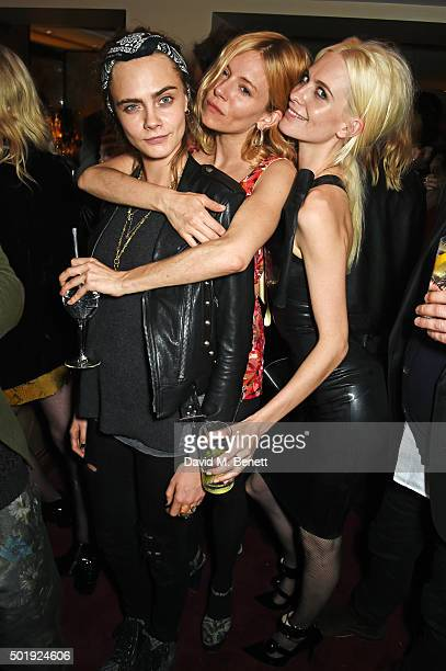 Cara Delevingne Sienna Miller and Poppy Delevingne attend the LOVE Christmas party at George on December 18 2015 in London England