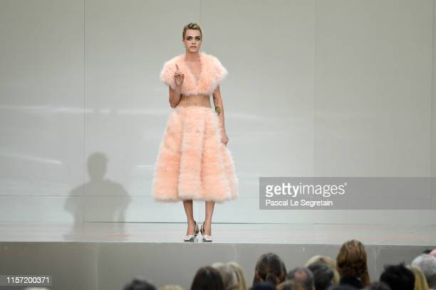 Cara Delevingne speaks on stage during the Karl Lagerfeld Homage at Grand Palais on June 20, 2019 in Paris, France.