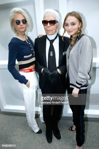 Cara Delevingne Stylist Karl Lagerfeld and LilyRose Depp pose after the Chanel show as part of the Paris Fashion Week Womenswear Fall/Winter...