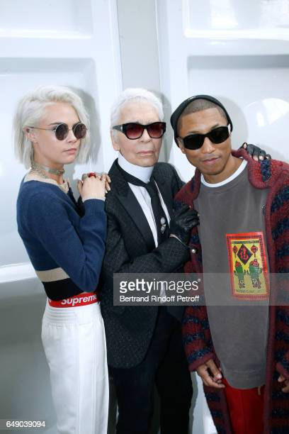 Cara Delevingne Stylist Karl Lagerfeld and Pharrell Williams attend the Chanel show as part of the Paris Fashion Week Womenswear Fall/Winter...