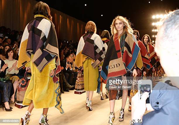 Cara Delevingne walks the runway at Burberry Womenswear Autumn/Winter 2014 at Kensington Gardens on February 17, 2014 in London, England.