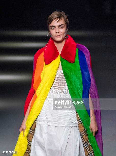 Cara Delevingne walks the runway at the Burberry show during London Fashion Week February 2018 at Dimco Buildings on February 17 2018 in London...