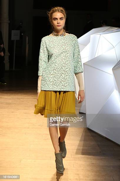 Cara Delevingne walks the runway at the Matthew Williamson show during London Fashion Week Fall/Winter 2013/14 at on February 17 2013 in London...