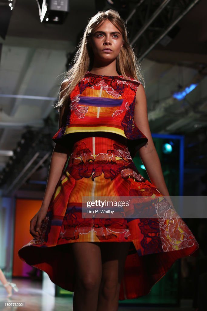 Cara Delevingne walks the runway at the Peter Pilotto show during London Fashion Week SS14 at Victoria House on September 16, 2013 in London, England.