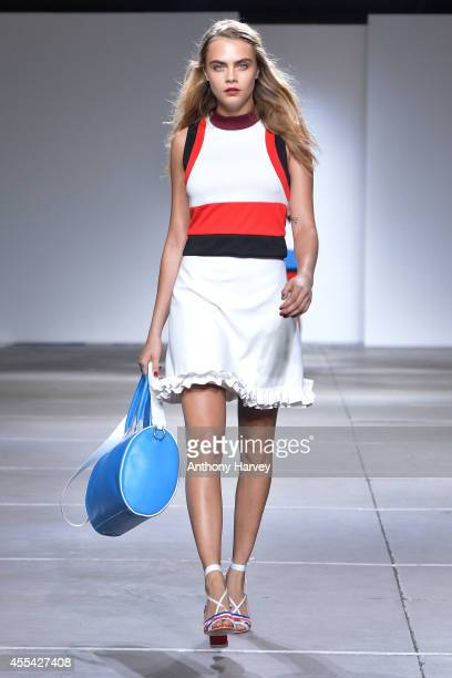 Cara Delevingne walks the runway at the TopShop Unique show during London Fashion Week Spring Summer 2015 on September 14 2014 in London England