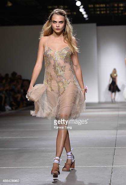Cara Delevingne walks the runway at the TopShop Unique show during London Fashion Week Spring/Summer 2015 at TopShop Show Space on September 14, 2014...