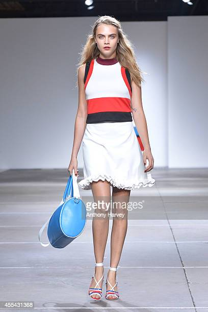 Cara Delevingne walks the runway at the TopShop Unique show during London Fashion Week Spring Summer 2015 on September 14, 2014 in London, England.