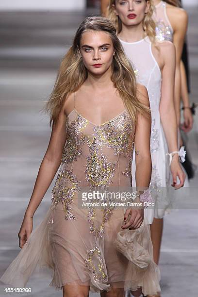 Cara Delevingne walks the runway at the TopShop Unique show during London Fashion Week Spring Summer 2015 at TopShop Show Space on September 14 2014...