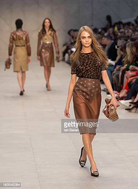 Cara Delevingne walks the runway during the Burberry Prorsum show during London Fashion Week Fall/Winter 2013/14 at Kensington Gardens on February 18...
