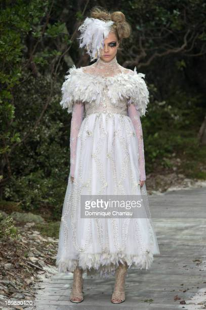 Cara Delevingne walks the runway during the Chanel Spring/Summer 2013 Haute-Couture show as part of Paris Fashion Week at Grand Palais on January 22,...