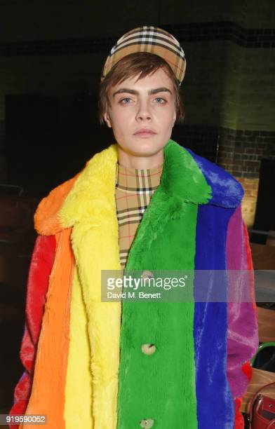 Cara Delevingne wearing Burberry at the Burberry February 2018 show during London Fashion Week at Dimco Buildings on February 17 2018 in London...