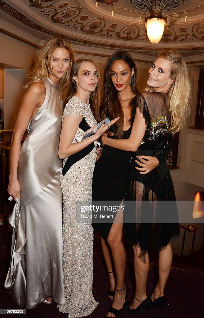 Cara Delevingne (2L), winner of the Model of the Year Award, poses with presenters Karlie Kloss, Joan Smalls and Poppy Delevingne attend the British Fashion Awards at the London Coliseum on December 1, 2014 in London, England.