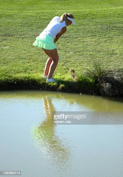 Cara Gainer of England plays from near the 18th greenside pond during The Rose Ladies Series at The Shire London on July 30 2020 in Barnet England