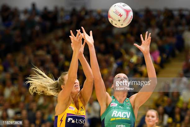 Cara Koenen of the Lightning and Emily Mannix of the Vixens compete for the ball during the round 6 Super Netball match between the Sunshine Coast...