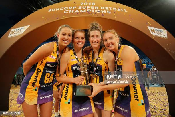 Cara Koenen Steph Wood Karla Pretorius and Madeline Mcauliffe of the Sunshine Coast Lightningpose for photo with their championship trophy after...