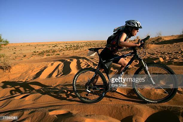 Cara Malzinskas from Inverloch Victoria pushes her bike up a dune during day three of the Simpson Desert Bike Challenge race on October 4 2007 in the...
