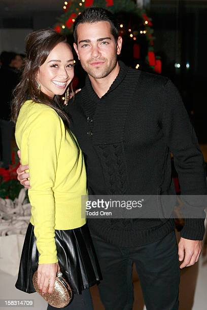 Cara Santana and Actor Jesse Metcalfe pose at the Hukkster Holiday Party at Private Residence on December 12 2012 in Los Angeles California