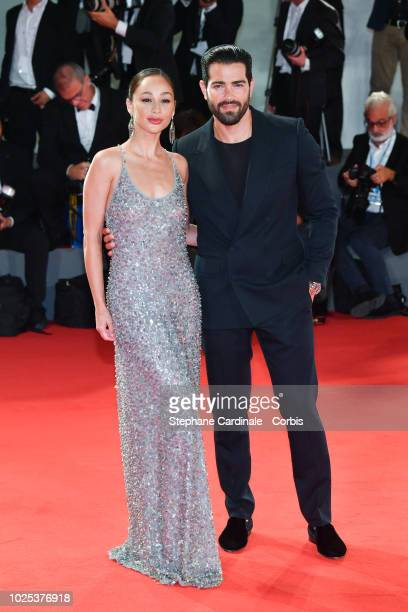 Cara Santana and Jesse Metcalfe walk the red carpet ahead of the 'The Favourite' screening during the 75th Venice Film Festival at Sala Grande on...