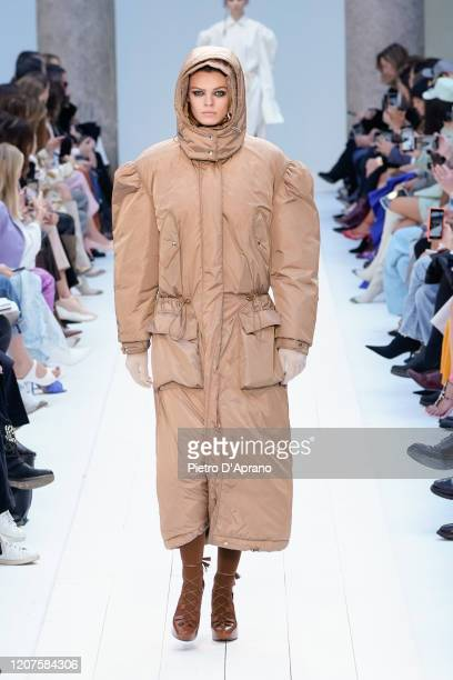 Cara Taylor walks the runway during the Max Mara fashion show as part of Milan Fashion Week Fall/Winter 20202021 on February 20 2020 in Milan Italy