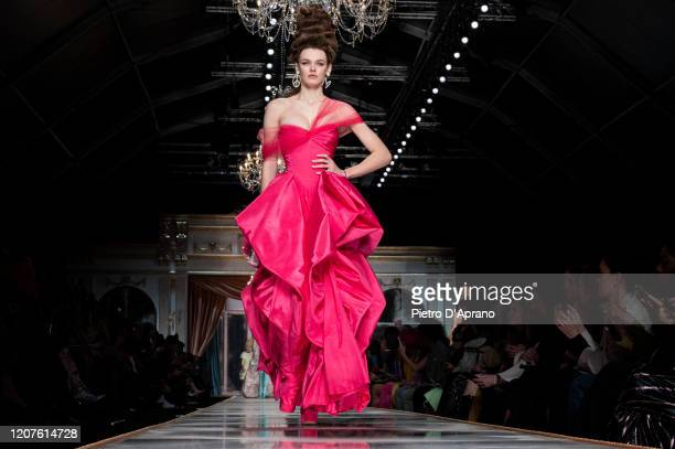 Cara Taylor walks the runway during the Moschino fashion show as part of Milan Fashion Week Fall/Winter 2020-2021 on February 20, 2020 in Milan,...