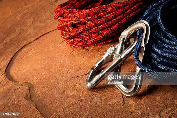 Carabiner Clip and Climbing Rope on Red Rock