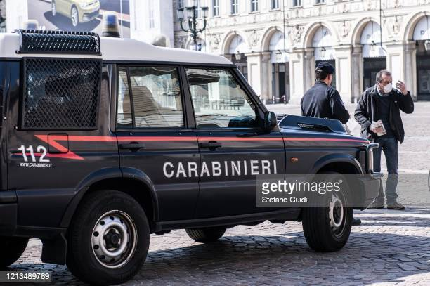 Carabinieri agents check in Piazza San Carlo in Turin during on the Italy Continues Nationwide Lockdown To Control Coronavirus Pandemic on March 19...