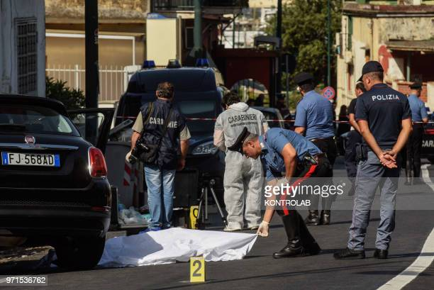 Carabinieri and scientific police at the scene of the murder of Agostino Di Fiore, who was shot dead with gun pistol in Naples city. The victim was...