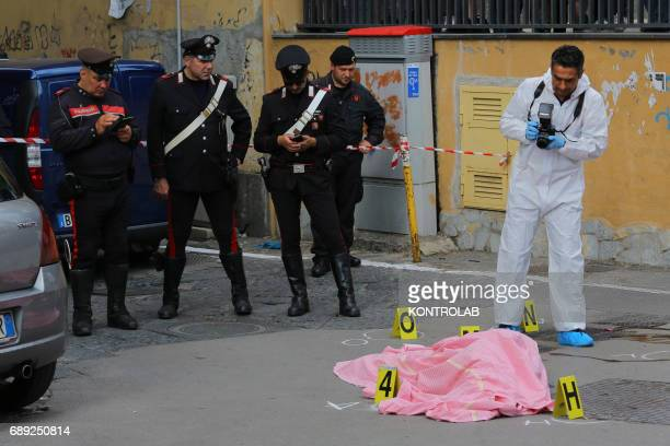 Carabinieri and Scientific police investigate on the place where they were killed while on board a scooter the 45yearold and the 22yearold whose name...