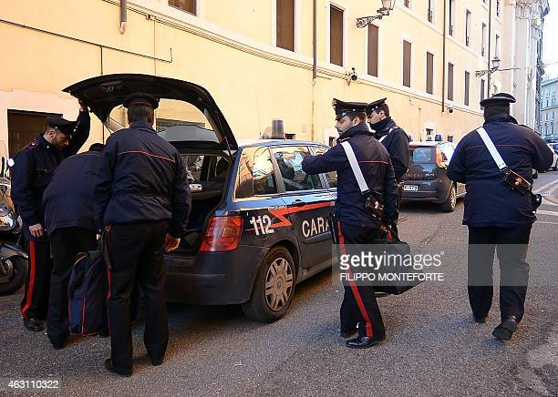 Carabinieri carry documents seized on February 10 2015 in Rome during a police operation against Roman crime organisation Italian police on Tuesday...