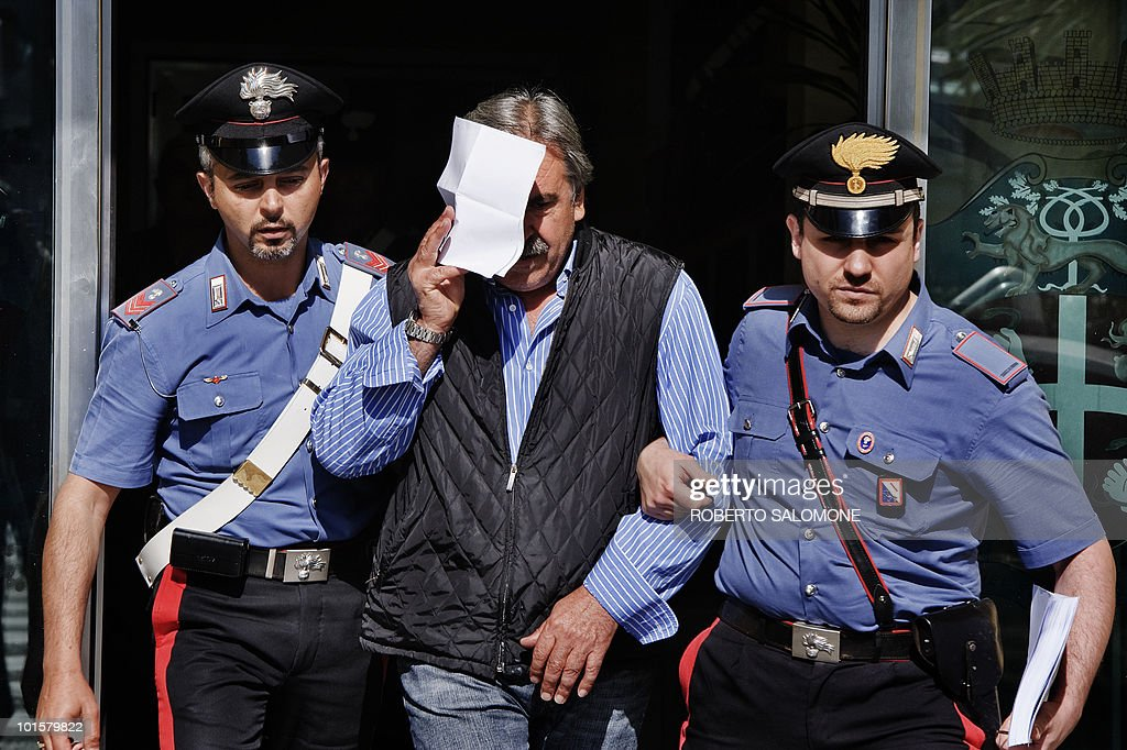 Carabinieri escort Carmine Diana (C) after an operation that culminated in the arrest of 14 people linked to the Casalesi mafia organisation on June 3, 2010. Among the arrested was Carmine D'Aniello, the lawyer of Casalesi mafia organisation boss Francesco Bidognetti.