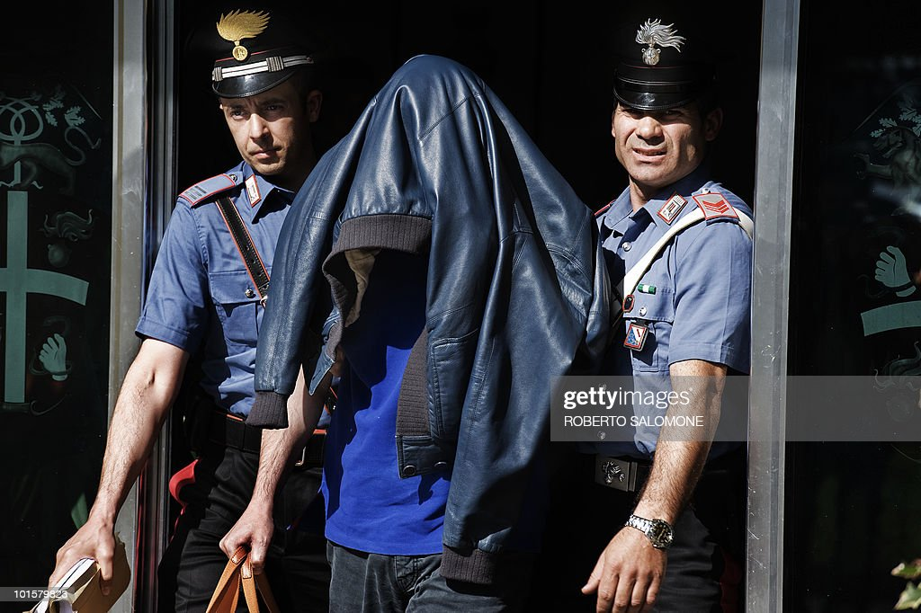 Carabinieri escort Giovanni Lubello (C) after an operation that culminated in the arrest of 14 people linked to the Casalesi mafia organisation on June 3, 2010. Among the arrested was Carmine D'Aniello, the lawyer of Casalesi mafia organisation boss Francesco Bidognetti.