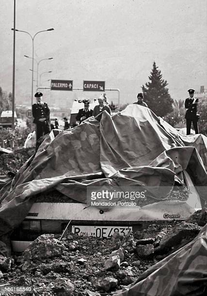 Carabinieri guarding the stretch of the motorway destroyed by the Mafia bomb attack which claimed the lives of Italian prosecuting magistrate...