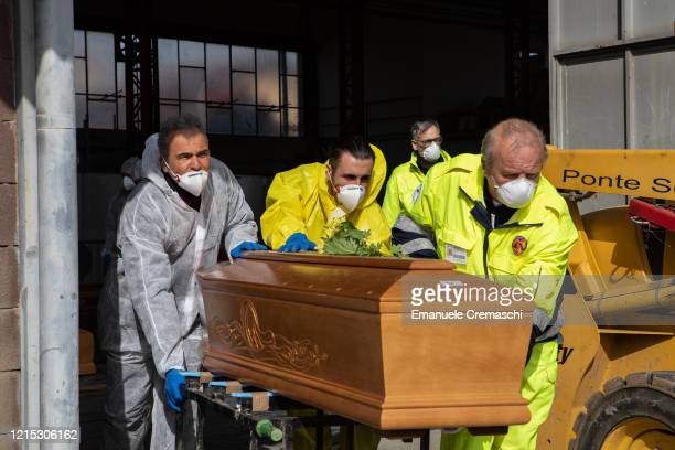 Carabinieri officers wearing protective suits transport coffins on March 28 2020 in Ponte San Pietro near Bergamo Northern Italy The Italian Army has...