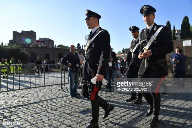 Carabinieri patrol before the arrival of Pope Francis for the Via Crucis torchlight procession at the Colosseum on Good Friday on April 14 2017 in...