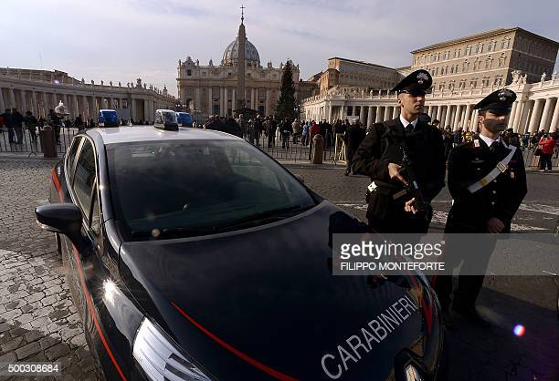 Carabinieri patrol in St Peter's square on the eve of the Feast of the Immaculate Conception and the launch of the Jubilee Year of Mercy on December...