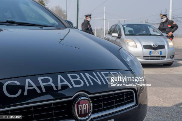 Carabinieri Police officers at the entrance of the Ponte della Libertà check that people have the documents in order to access Venice on March 12...