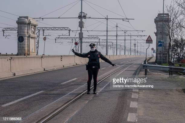 Carabinieri police officers stop cars at the entrance of the Ponte della Libertà on March 12 2020 in Venice Italy Italy has decided to close all...
