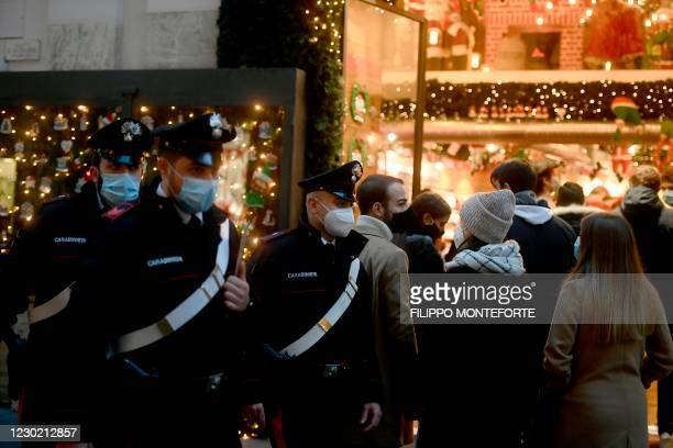 Carabinieri policemen patrol as people do their Christmas shopping in central Rome on December 19, 2020 during the COVID-19 pandemic caused by the...