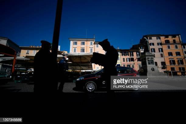 Carabinieri policemen perform controls at the Campo dei Fiori square on March 16 2020 in Rome