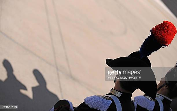 Carabinieri policemen stand guard as an Air France plane with Pope Benedict XVI aboard lands at Ciampino airport in Rome on September 15 2008 I will...